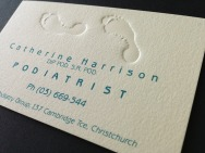 Catherine Harrison Podiatrist logo on embossed business card. Brands for New Zealand companies, Christchurch, New Zealand.
