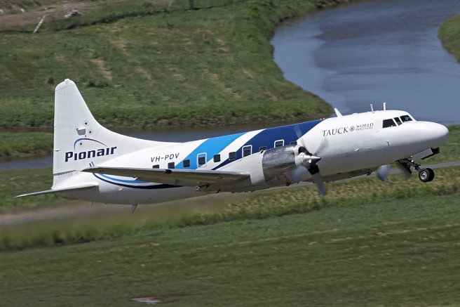 Convair CV580 VH-PDV, dynamic air-to-air view, newly repainted and sporting the new Pionair aircraft livery 'dynamic swoops'. Designed by Shaun Waugh as part of the 2006 Pionair rebrand.