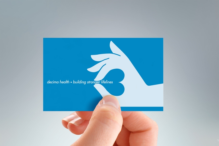 Verso of Decima Health business card, two colours, black and blue, two-sided design.