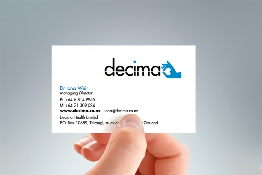 Hand-held portrait of the front of the Decima Health two-sided design business card