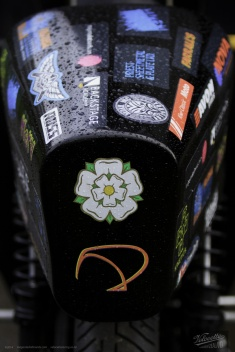 Carbon fibre seat of Eldee Velocette classic racing motorcycle, rear view of sponsors logo array