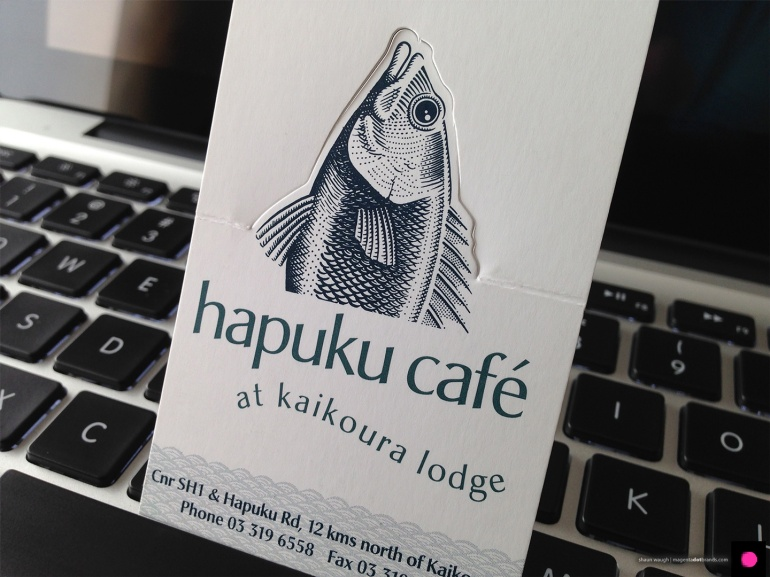 Novel pop-up Hapuku Cafe and Lodge logo business card in the 'closed' state.