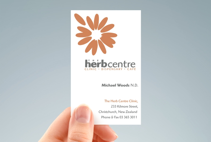 Hand-held portrait of the front of the Herb Centre business card