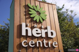 Herb Centre Kilmore Street Signage, building exterior: Carl Pavletic / Herb Centre joint addition to the Surface Active branding's graphical standard.