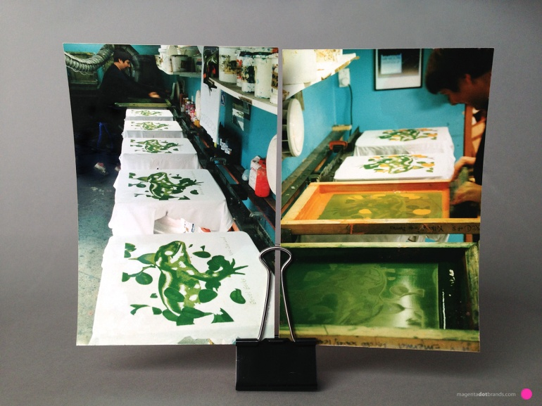 Synchronised with Deborah printing the second colour, dark green, Chrissie prints the third colour orange. Because the area of these prints is small the dark green colour does not present the problem of adhering to bottom of the following orange stencil.