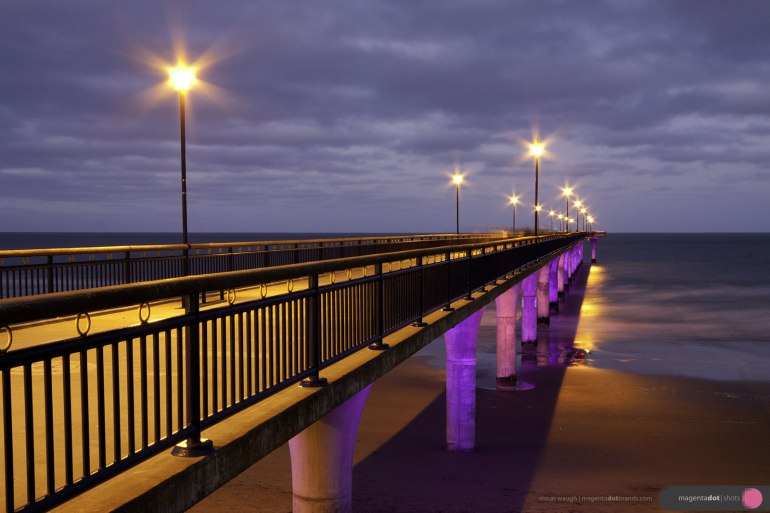 New Brighton Pier, illuminated at night by WindsorUrban luminaires and lighting poles. photo shot for WindsorUrban website redesign and rebrand project