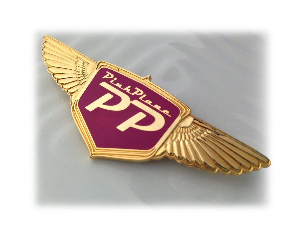 Pink Plane logo and badge