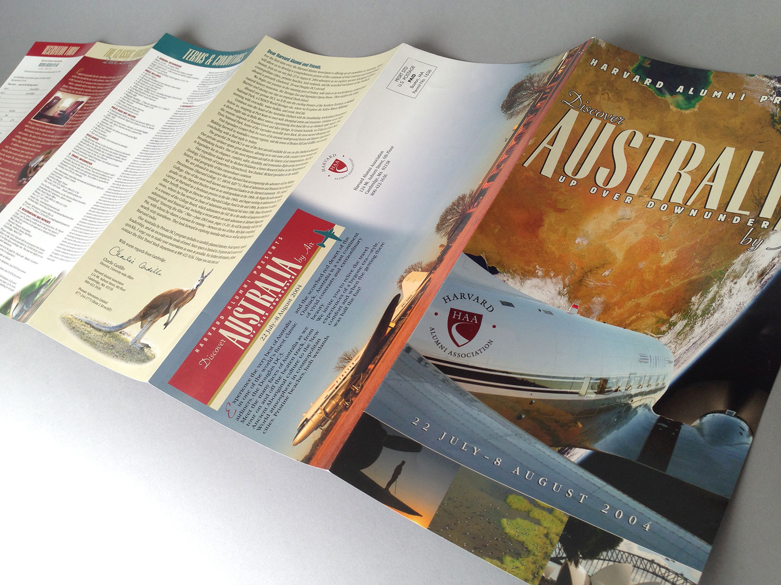 Pionair / Harvard Alumni Association 'Discover Australia by air' rollover 12-page brochure, front cover and outside six pages spread out flat.