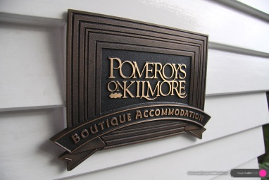 Pomeroy's Boutique Accommodation cast bronze multi-level name plate located by the front door.