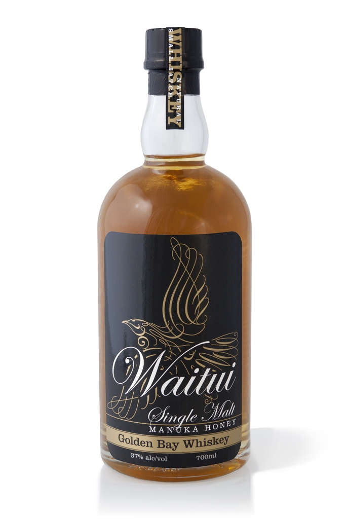 Waitui Single Malt Manuka Honey Golden Bay Whiskey packaging label. Small batch Whiskey, barrel aged 4 years. Hand crafted in Takaka, New Zealand.