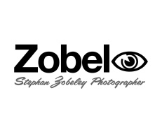 "Zobeley: Stephan Zobeley Photographer logo / rebus puzzle, the third syllable in Zobeley ""ey"" is represented by a picture of an ""eye"". This visual double-entendre is also an effective way to ensure the client's name is correctly pronounced as ""Zobeleye"". Christchurch, New Zealand. Brands for New Zealand and international companies."