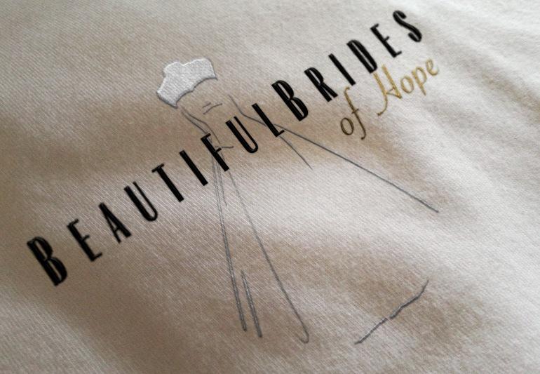 Closeup of Beautiful Brides of Hope bridal couture logo screenprinted on a teeshirt. Hope, Nelson, New Zealand. Logo design, illustration, Christchurch New Zealand
