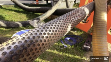 """The business end of a """"well-point dewatering system"""", the 5m long dewatering lance. Horizontal Directional Drilling, Tru-Line Civil, documentary photography, Parklands West, Christchurch, New Zealand, Gravity Wastewater Replacement, HDD."""
