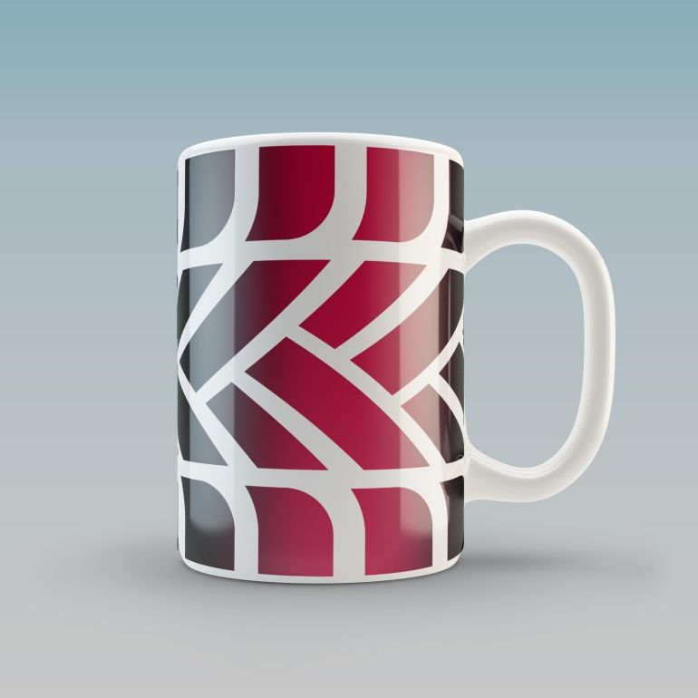 A white glazed ceramic mug with the MTC logo tyre tread pattern graphic wrapped around it.