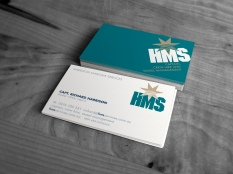 "Stacked Harrison Maritime Services ""HMS"" business cards showing both sides of the card."