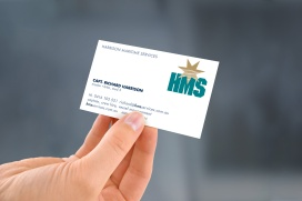 "Hand-held Harrison Maritime Services ""HMS"" business card."