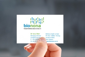 Hand-held photorealistic mockup of front of Bionona business card, printed in 4 colours, litho offset.