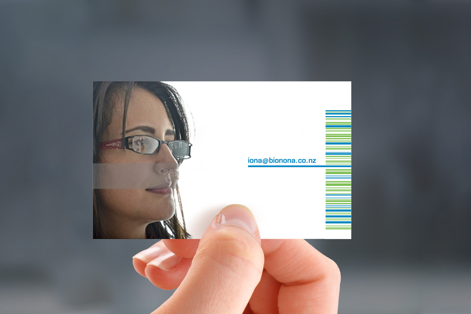 Hand-held photorealistic mockup of back of Bionona business card, printed in 3 colours, litho offset