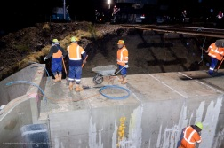 Concreting the steel reinforced wing wall joints.