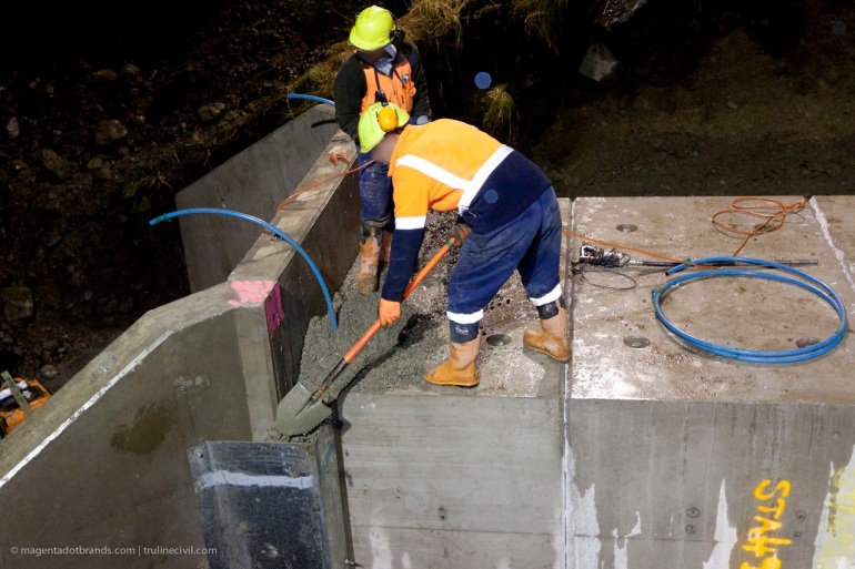 The penultimate task. Filling the western wing wall joint boxing with concrete the old fashioned way.