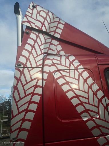 Metallic silver logo tyre tread decal