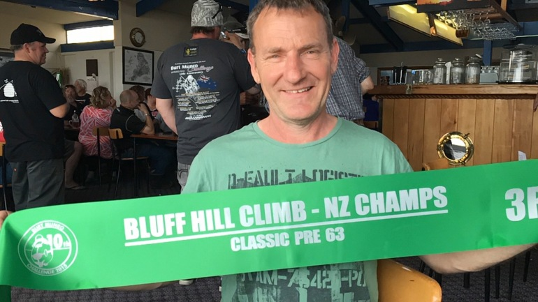 VRNZ Team leader Phil Price with Graham Peter's Bluff HIll Climb Pre '63 Class sash at the Anchorage Pub, venue for the debrief after the event on Thursday evening.