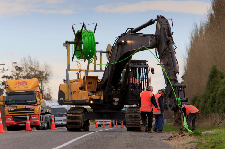 Volvo excavator, Ripper mole ploughing, State Highway 1