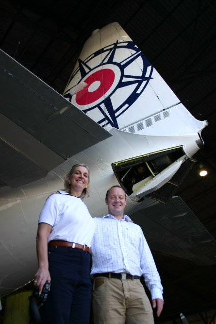Tim Scott and Robin Tauck beneath the vertical stabiliser of Pionair Australia's Convair VH-PDV.