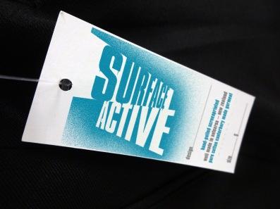 Surface Active T-shirt swingtag front.