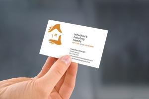 Heather's helping hands business card, two colour, two-sided design.