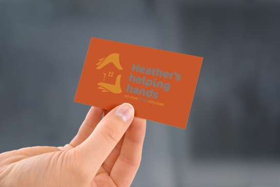 Back of Heather's helping hands' business card rejected draft two colour design.