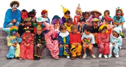 Two dozen Primary school children in clown costumes are happy customers.