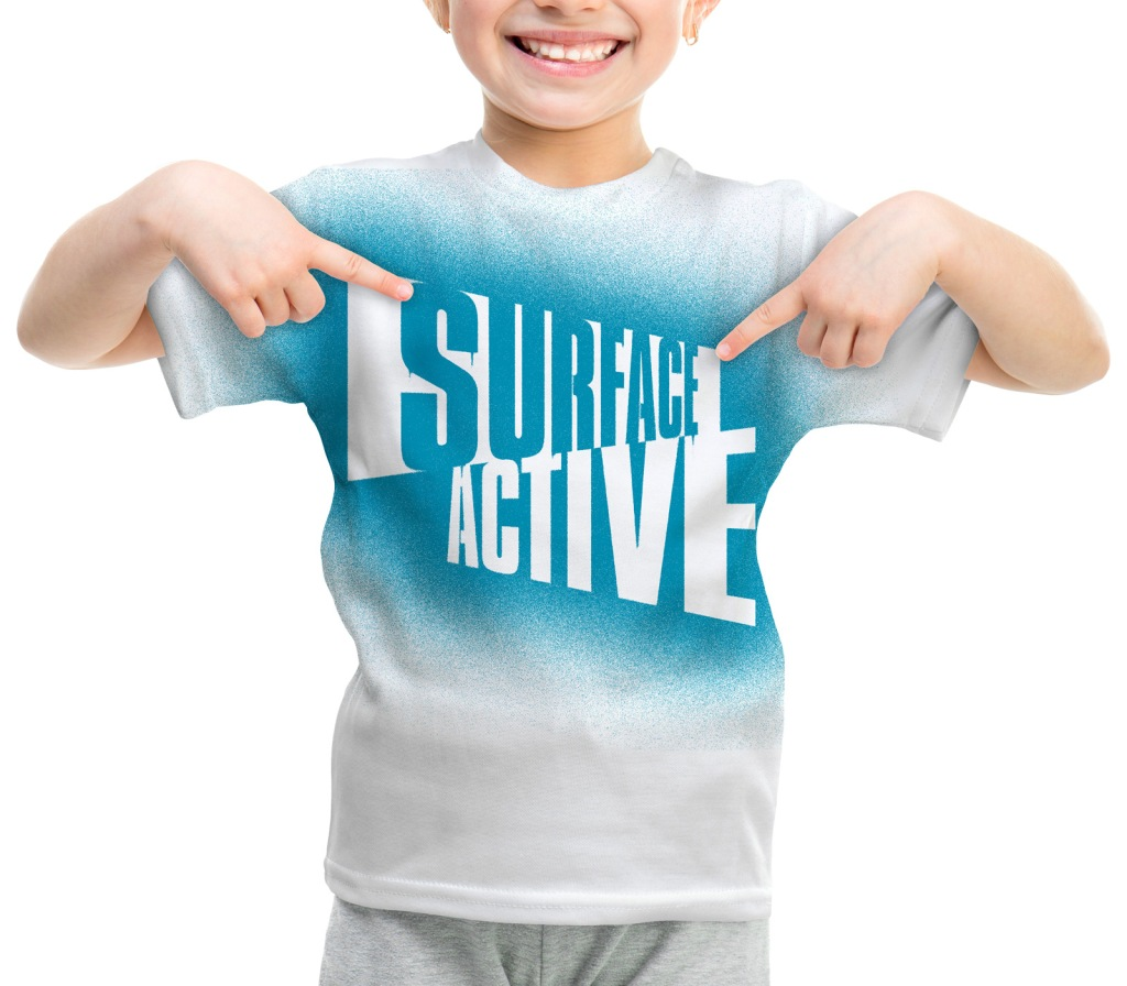 SurfaceActive logo airbrushed onto a child's white teeshirt