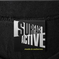 Surface Active made in Aotearoa, T-shirts main neck label.