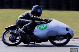 "Phil Price riding a girder fork 1930s Velocette MOV approaches the hairpin in a Hampton Downs Summer Classic 250 Clubman's race. The MOV were renowned in the day for their innovative ""dustbin"" fairing."