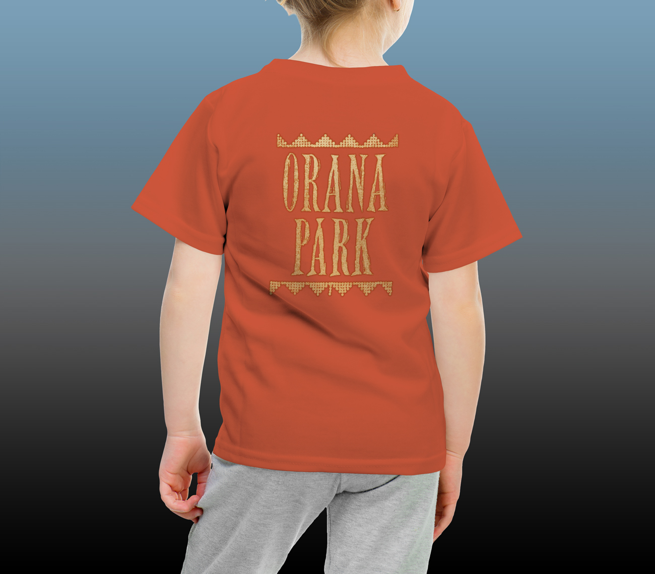 Orana Park kids' Cheetah screen print on the back of a burnt orange T-shirt