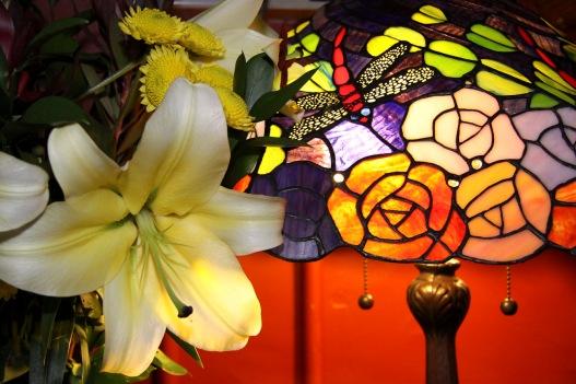 Pomeroy's Old Brewery Inn English style pub interior details. Art Deco lamp and fresh cut flower arrangement.