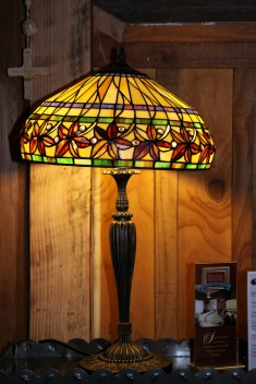Pomeroy's Old Brewery Inn English style pub interior details. Art Deco lamp and wood panelling.