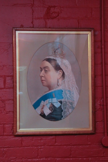 Pomeroy's Old Brewery Inn English style pub interior details. Portrait of Queen Victoria.