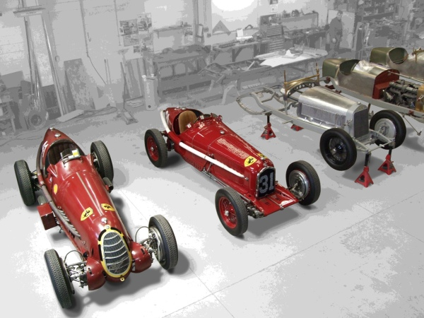 """Three historic Alfa Romeo racing cars of the 1930s, including one of only three Tips B """"P3"""", are lined up in the Auto Restorations workshop."""