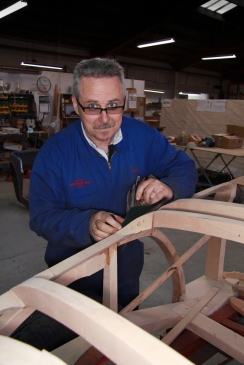 Glen Moore planes the Southern Beech wood subframe for a classic Hispano Suiza restoration in the Custom Coachbuilding Shop at Auto Restorations.