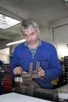Joseph McClintock at work on a bespoke re-created chassis part in the Mechanical Shop at Auto Restorations.