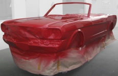 Red Mustang, freshly painted in Paint Shop spray booth.