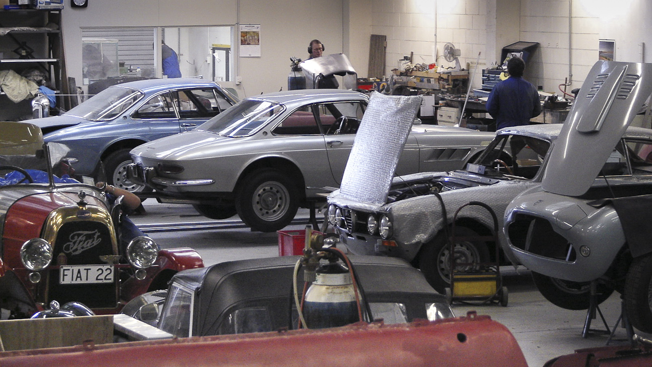 Line up of in-progress restorations of rare mid-century classics in the Panel Shop and at Auto Restorations. From front to back a Siata 280CS Balbo, an Alfa Romeo and a pair of Ferrari.