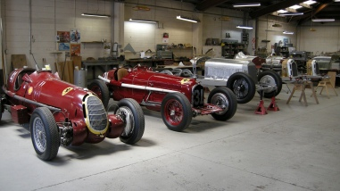 "Line up of the in-progress ""race preparation"" of a team of Alfa Romeo classic racing cars in the Panel Shop and at Auto Restorations."