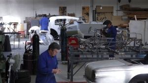 Bob Sterling and Andy Wiley go about their tasks in this wide view of the Panel Shop and Custom Coach Shop at Auto Restorations