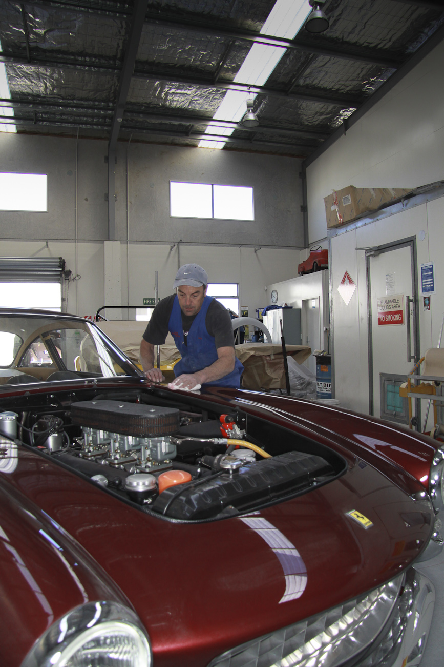 Peter Hendricks putting the finishing touch on the Concours award winning paint job of a complete Ferrari Lusso restoration, Paint Shop, Auto Restorations.