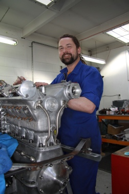 Richard Hope at work on rebuilding a classic V8 engine in the Mechanical Shop at Auto Restorations.
