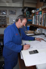 Rob Selby working on a bespoke blueprint of part to be machined for a classic restoration in the Auto Engineering Shop at Auto Restorations.