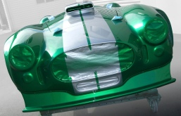 Green Shelby Cobra with two silver stripes, freshly painted in Paint Shop spray booth.